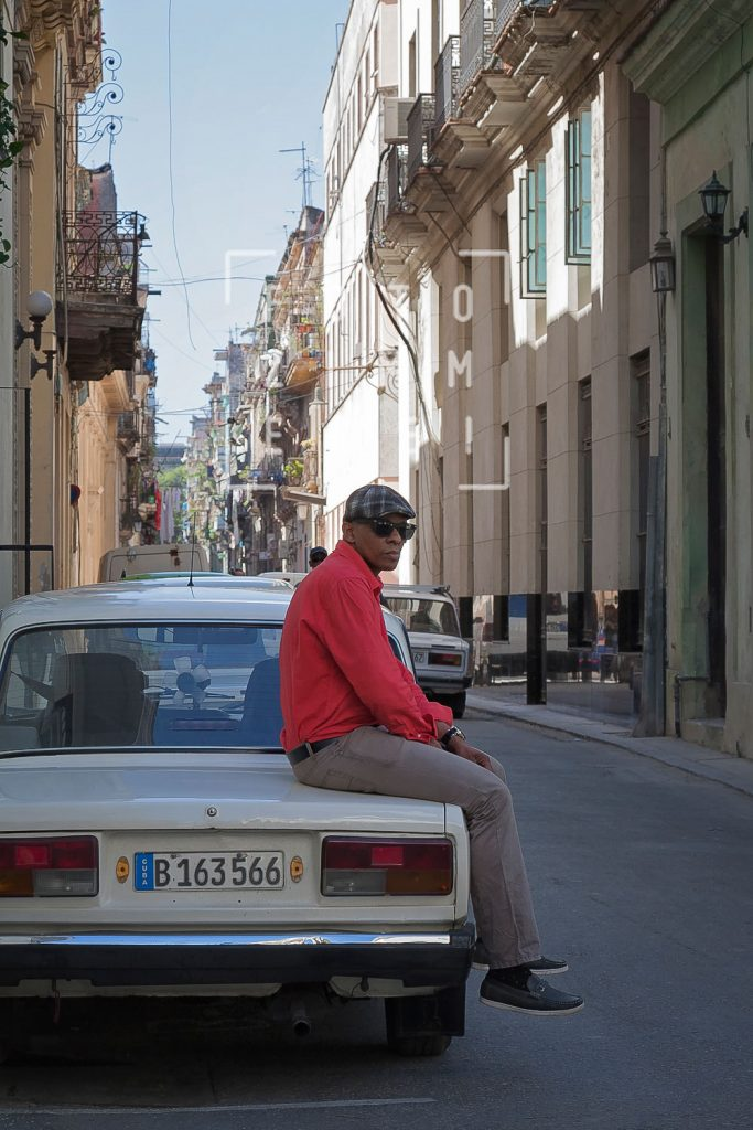 man sitting on a car