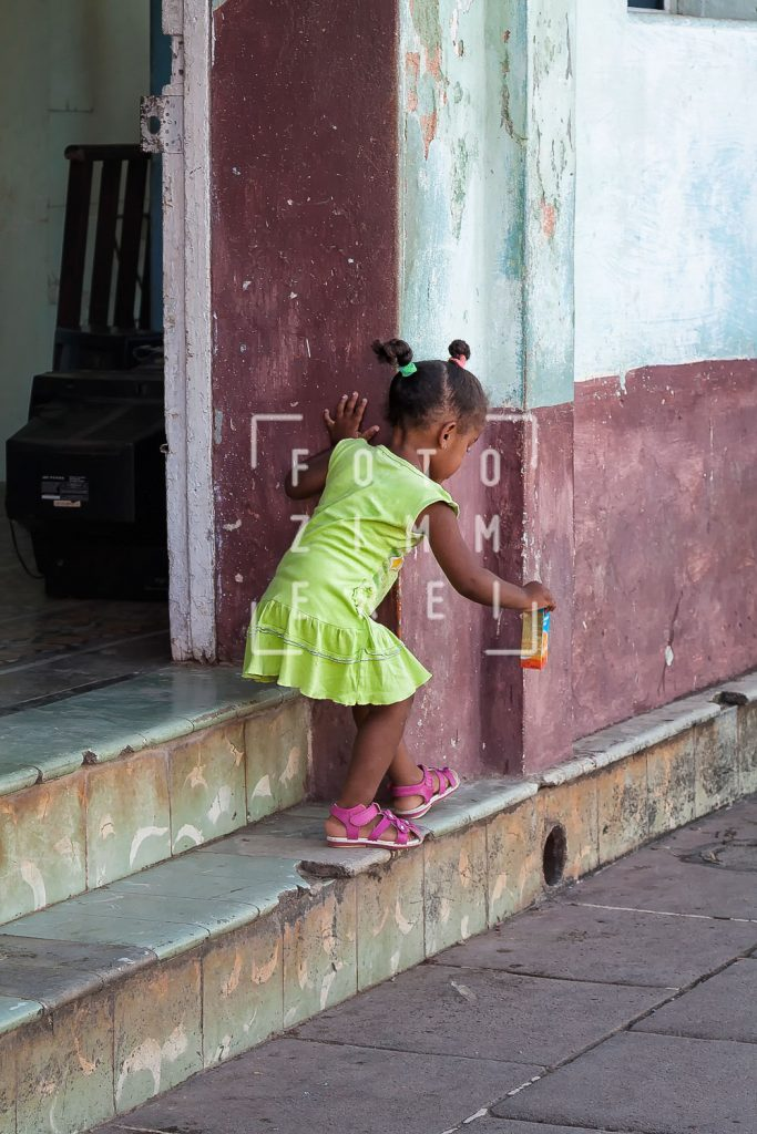 little girl at the door steps in havanna