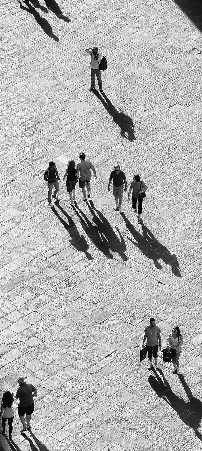 view from the top of a tower people and shadows