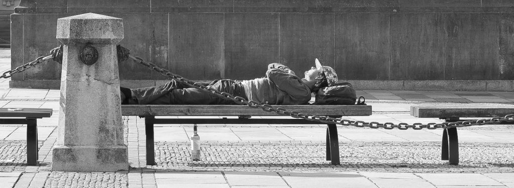 men relaxing on a bench